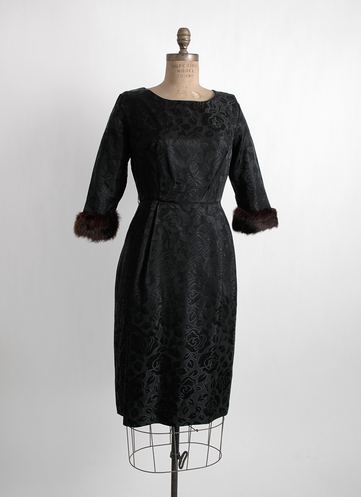 1960s black satin-y dress with fur cuffs