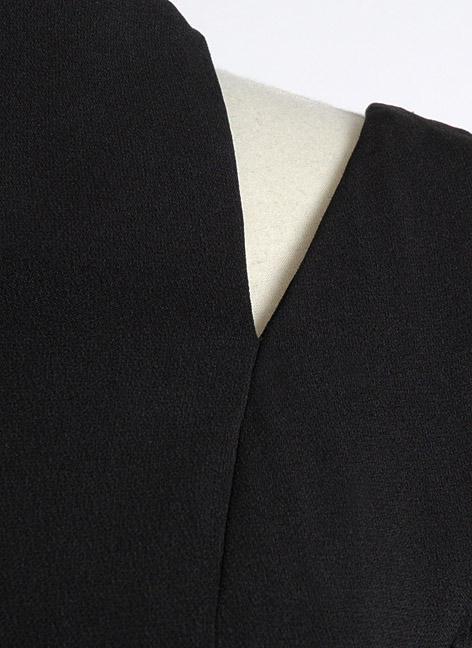 1950s Luis Estévez black crepe cocktail dress with cutouts