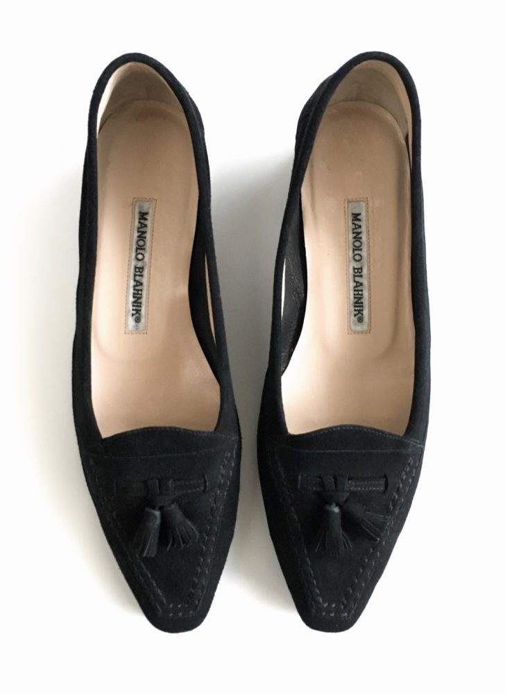 black suede Manolo Blahnik flats with tassels