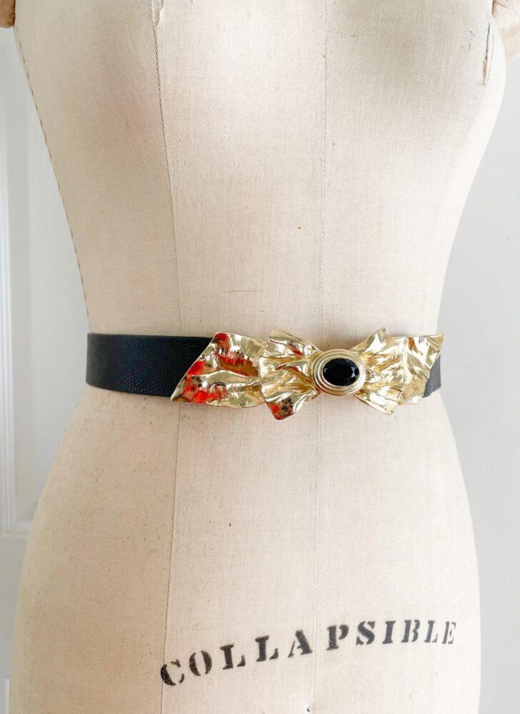 1980s Mimi Di Niscemi bow buckle black faux snakeskin belt