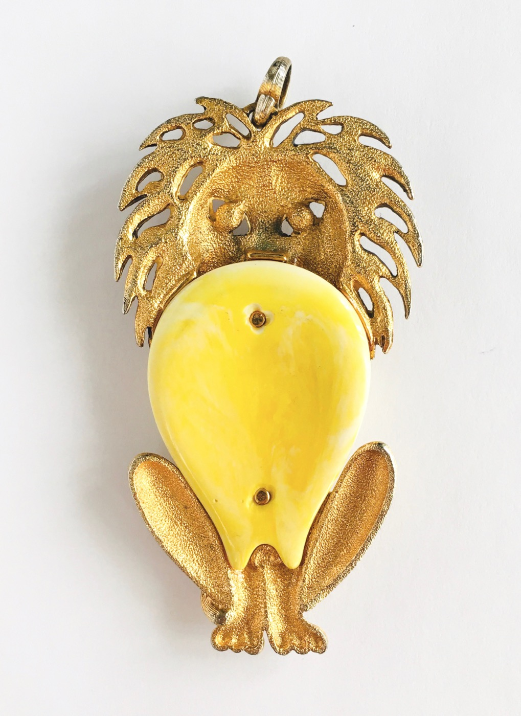 70s brass + yellow lucite lion pendant