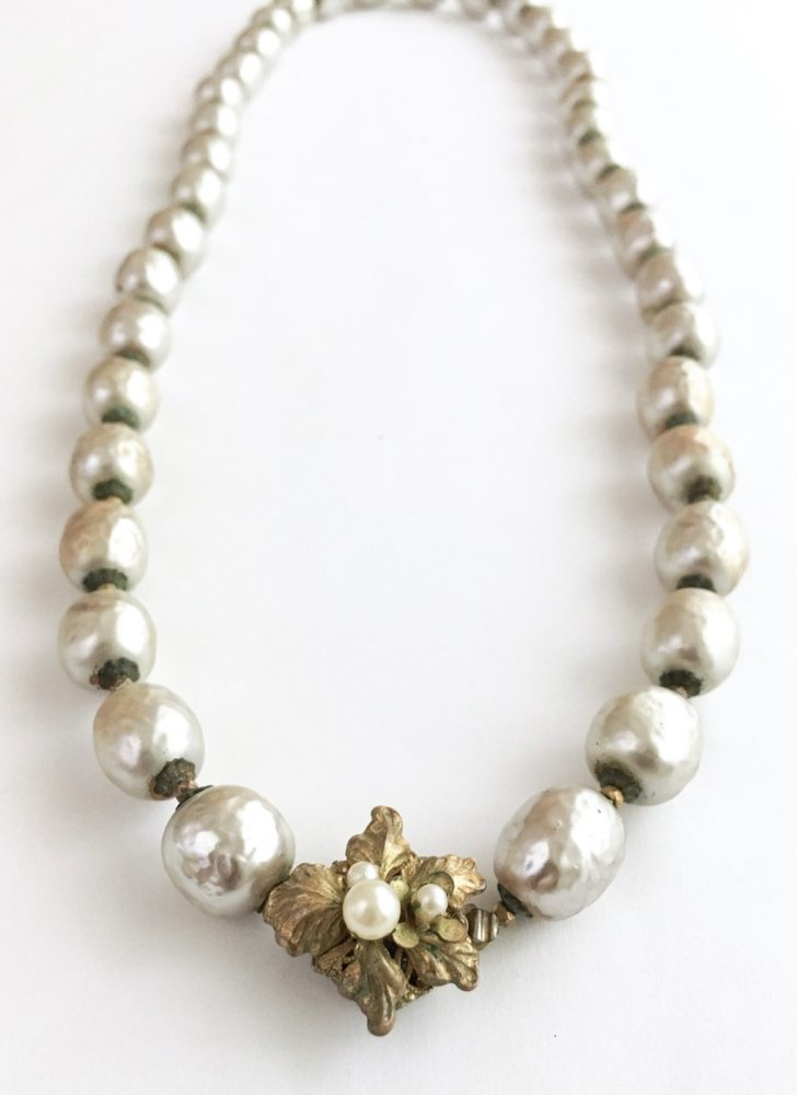 1950s Miriam Haskell baroque pearl necklace with a brass flower box clasp