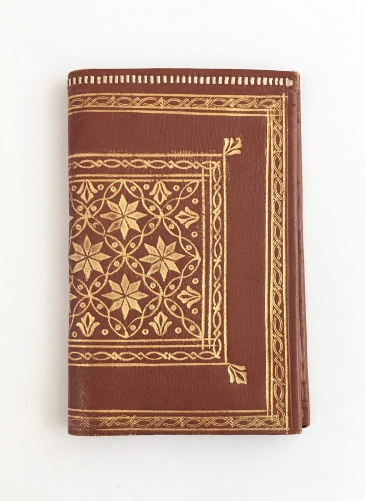 antique Florentine brown leather wallet embossed with gold design