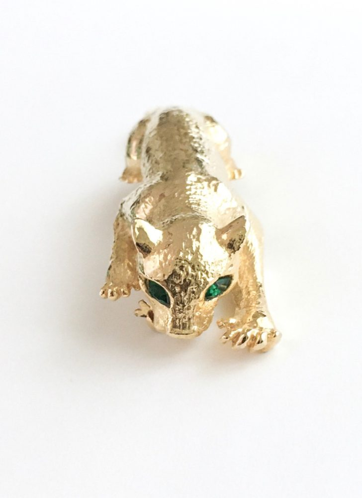 vintage gold plated panther pin brooch with green rhinestone eyes