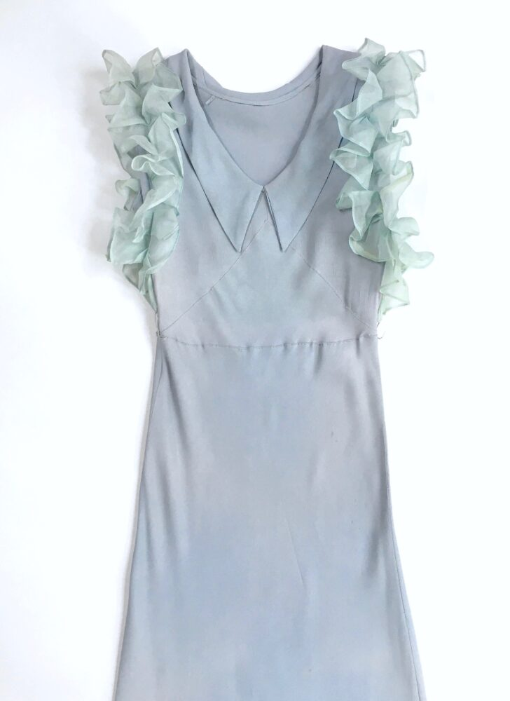 1930s blue crepe bias cut gown with organza ruffle sleeves and hem (discolored)