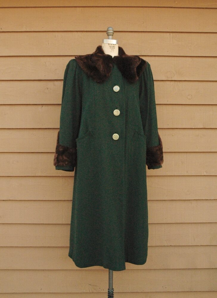 1940s green wool coat with Deco buttons + beaver trim