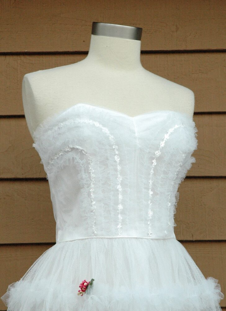 white strapless 1950s crinoline rose corsage party formal dress