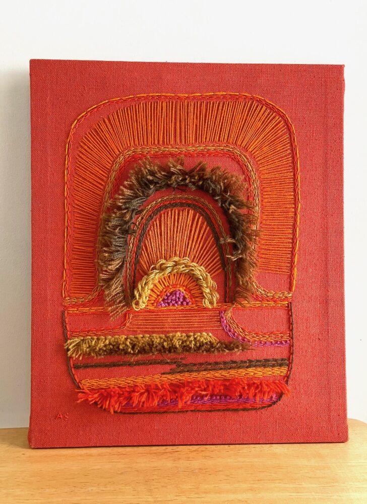 1970s orange yarn embroidery fiber art wall hanging
