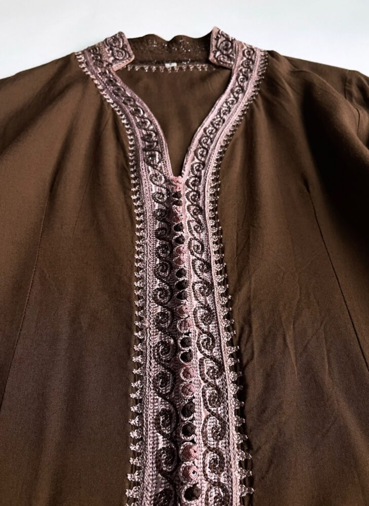 brown jacket with purple embroidery and buttons